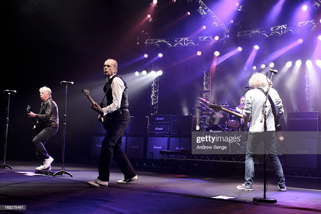 Rick Parfitt, Francis Rossi, Matt Letley and Alan Lancaster of Status Quo performs on stage in concert at Manchester Apollo on March 6, 2013 in Manchester, England.