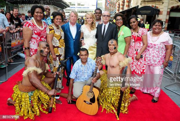 Rick Parfitt Laura Aikman and Francis Rossi are joined by performers as they arrive at the premiere of new film Bula Quo at the Odeon West End cinema...