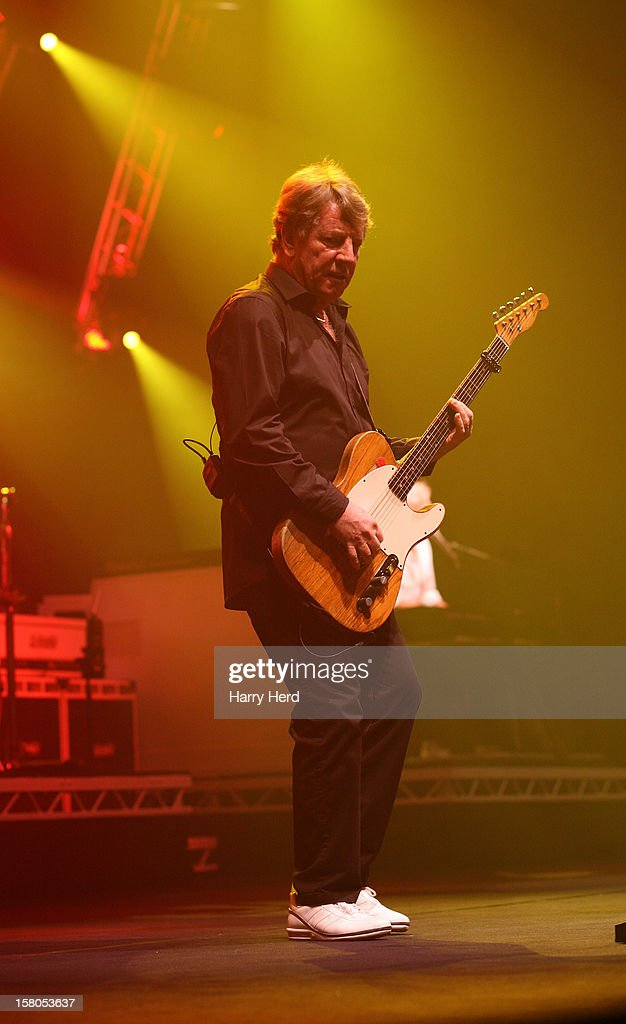 <a gi-track='captionPersonalityLinkClicked' href=/galleries/search?phrase=Rick+Parfitt&family=editorial&specificpeople=226912 ng-click='$event.stopPropagation()'>Rick Parfitt</a> of Status Quo performs at Quofestive at BIC on December 9, 2012 in Bournemouth, England.