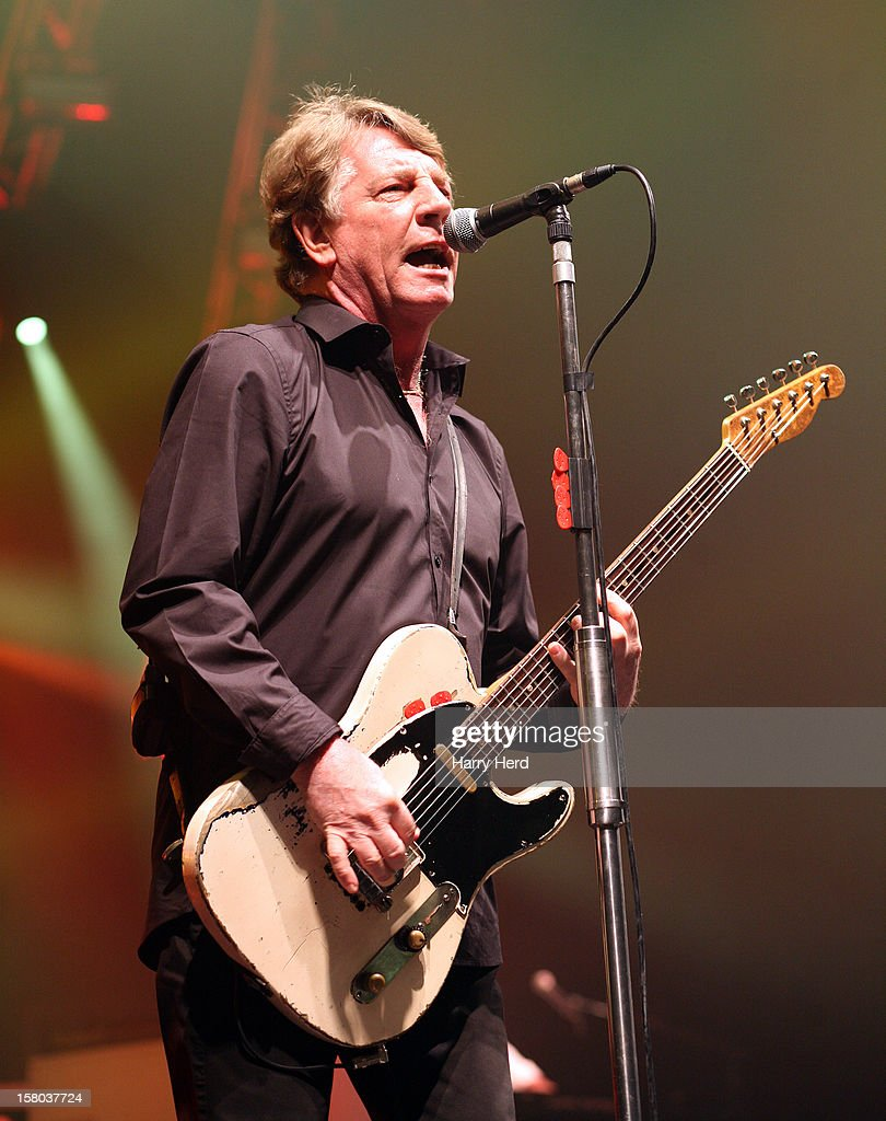 <a gi-track='captionPersonalityLinkClicked' href=/galleries/search?phrase=Rick+Parfitt&family=editorial&specificpeople=226912 ng-click='$event.stopPropagation()'>Rick Parfitt</a> of Status Quo performs at Quofestive at the BIC on December 9, 2012 in Bournemouth, England.