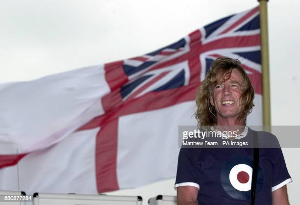 Rick Parfitt of Status Quo prior to playing on the the HMS Ark Royal in Portsmouth The band staged a concert for fans and sailors to promote their...
