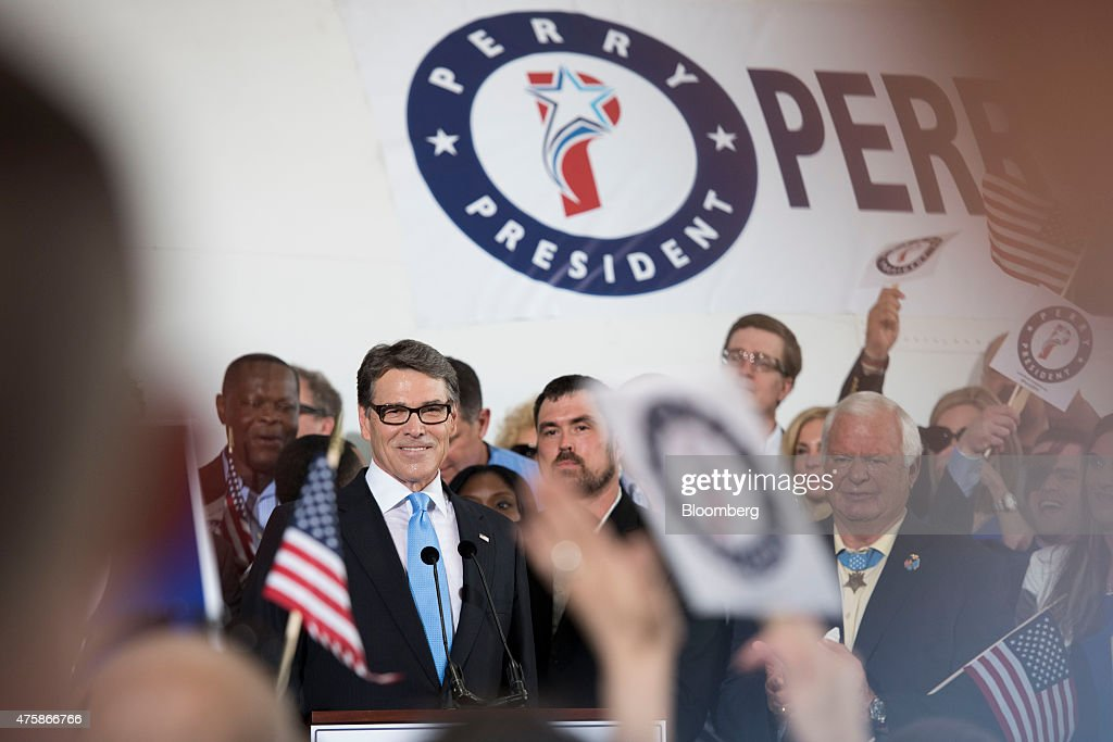 Rick Perry former governor of Texas smilles while speaking during an event to formally announce his presidential campaign in a hangar at Addison...