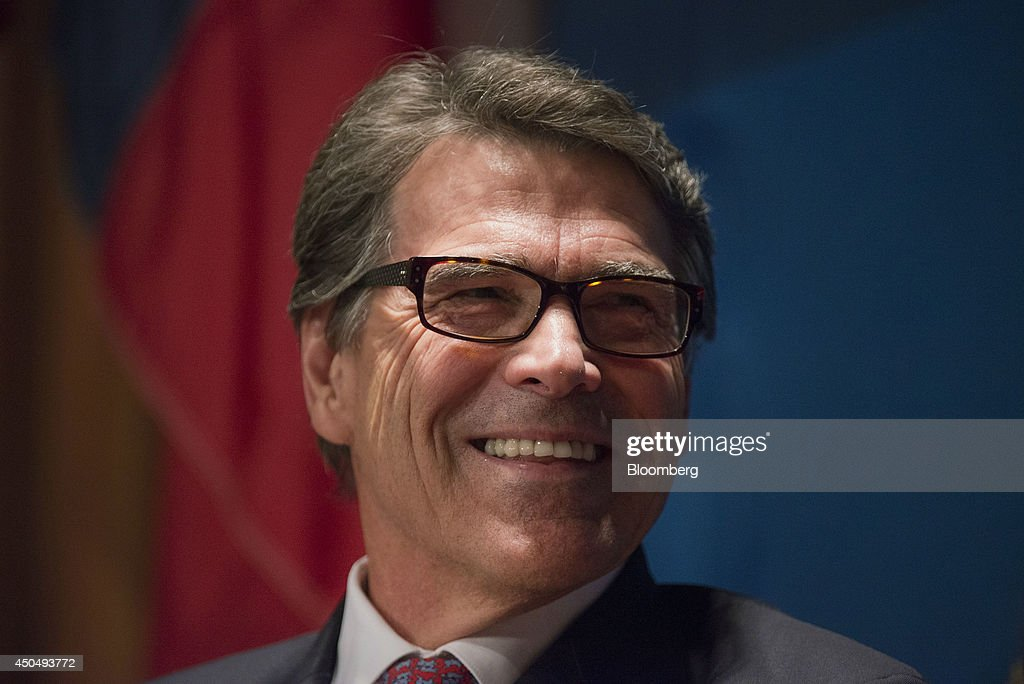 <a gi-track='captionPersonalityLinkClicked' href=/galleries/search?phrase=Rick+Perry+-+Politician&family=editorial&specificpeople=175872 ng-click='$event.stopPropagation()'>Rick Perry</a>, governor of Texas, smiles while speaking at the Commonwealth Club of California in San Francisco, California, U.S., on Wednesday, June 11, 2014. Perry's speech touched on several topics including economic issues saying that Californians should be deeply concerned about the deteriorating business climate in their state. Photographer: David Paul Morris/Bloomberg via Getty Images