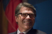 Rick Perry governor of Texas smiles while speaking at the Commonwealth Club of California in San Francisco California US on Wednesday June 11 2014...