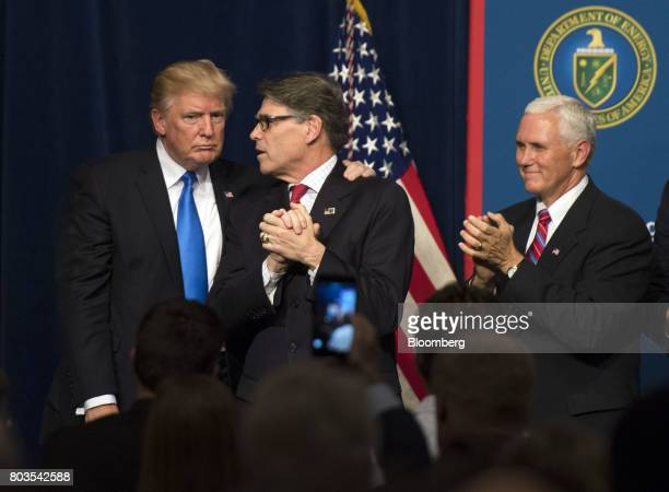 Rick Perry US secretary of energy right speaks while US President Donald Trump listens and Vice President Mike Pence applauds during the Unleashing...