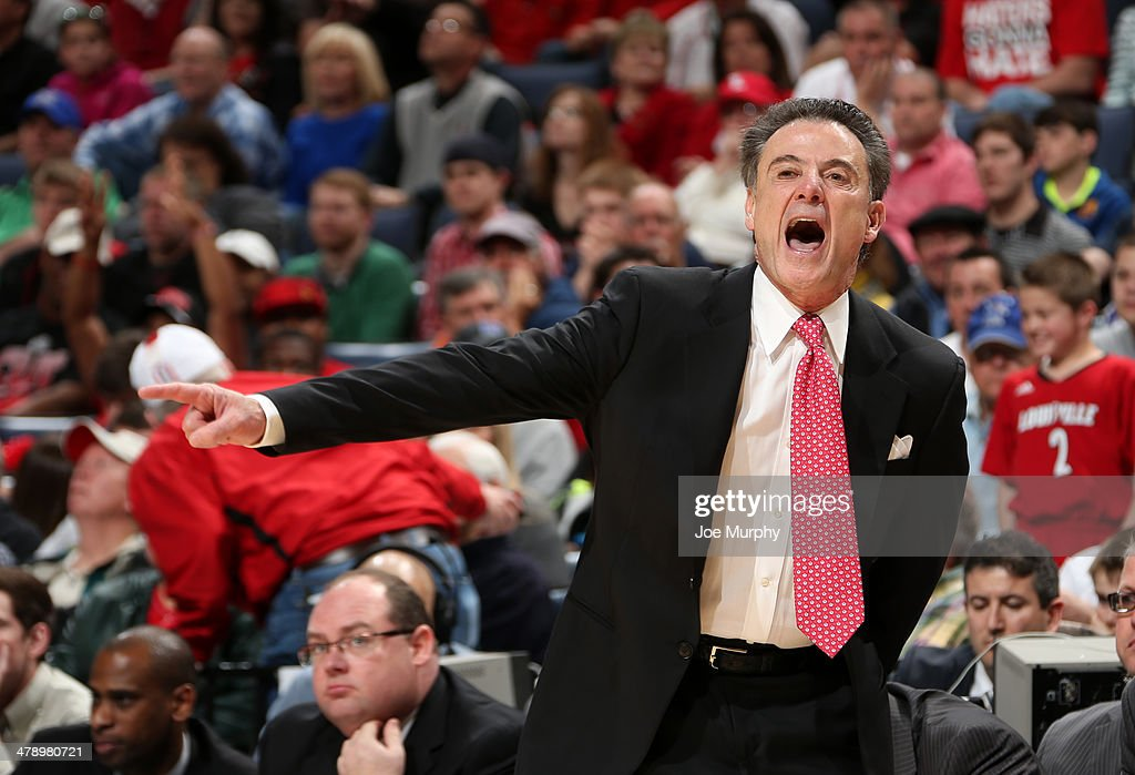 Rick Pitino, head coach of the Louisville Cardinals coaches from the sideline against the Connecticut Huskies during the Championship of the American Athletic Conference Tournament at FedExForum on March 15, 2014 in Memphis, Tennessee. Louisville defeated Connecticut 71-61.