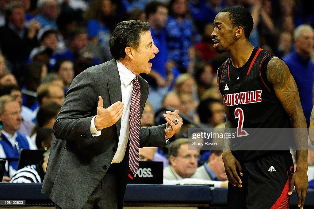 Rick Pitino, head coach of the Louisville Cardinals discusses a play with Russ Smith #2 during a game against the Memphis Tigers at FedExForum on December 15, 2012 in Memphis, Tennessee.