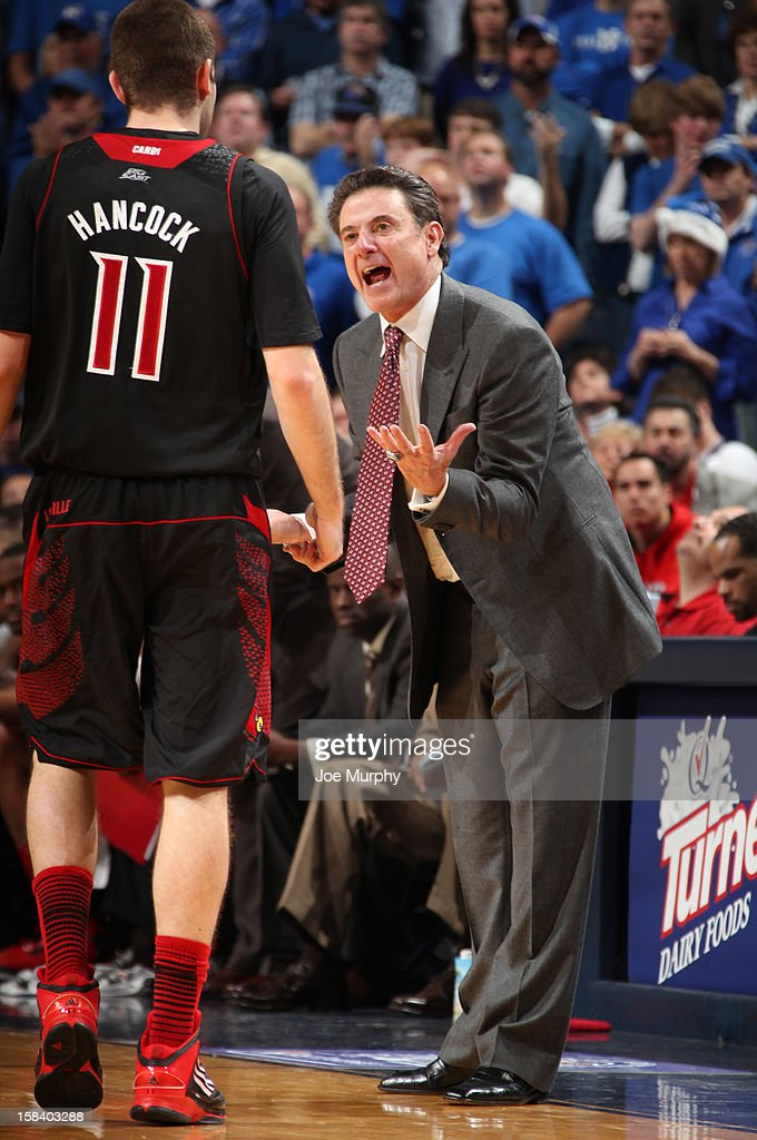 Rick Pitino, head coach of the Louisville Cardinals yells at Luke Hancock #11 of the Louisville Cardinals during a game against the Memphis Tigers on December 15, 2012 at FedExForum in Memphis, Tennessee.