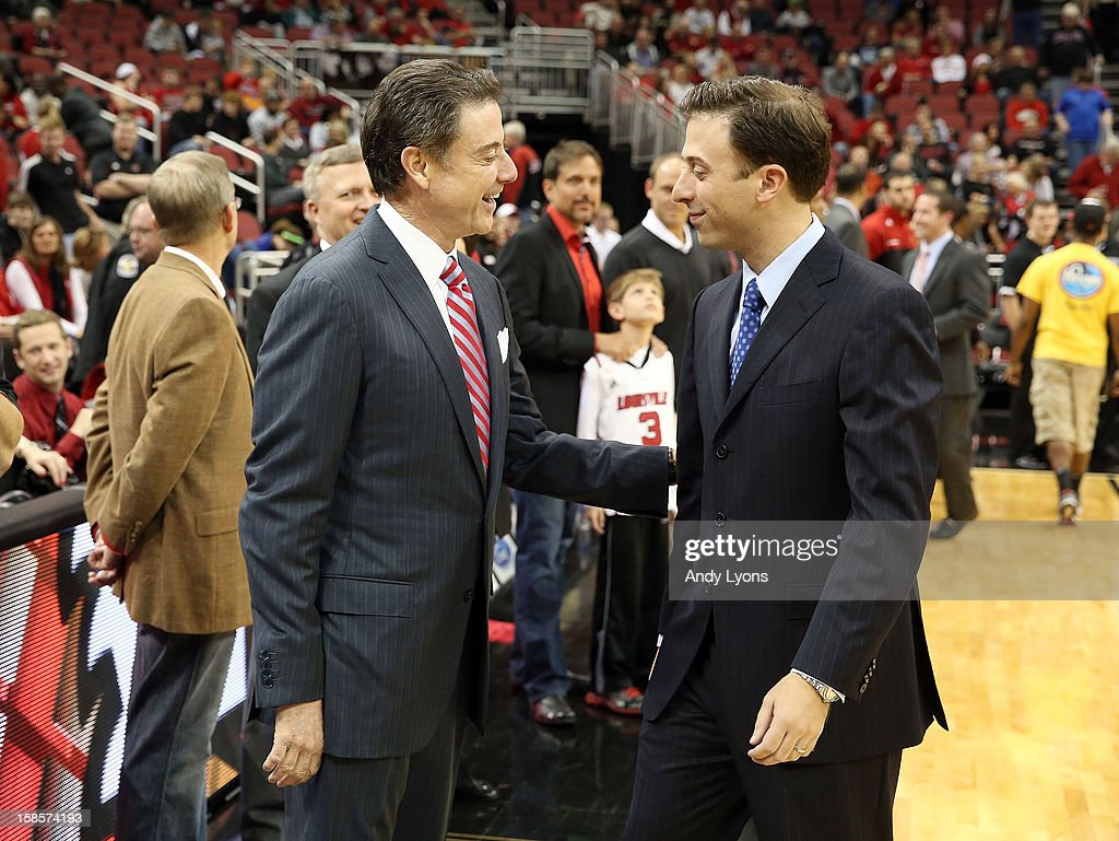 Rick Pitino the head coach of the Louisville Cardinals and Richard Pitino the head coach of the Florida International Panthers meet before the game in the Billy Minardi Classic at KFC YUM! Center on December 19, 2012 in Louisville, Kentucky.