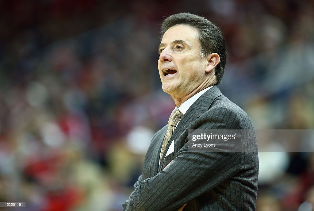 Rick Pitino the head coach of the Louisville Cardinals givees instructions to his team during the game against the Southern Mississippi Golden Eagles at KFC YUM! Center on November 29, 2013 in Louisville, Kentucky.