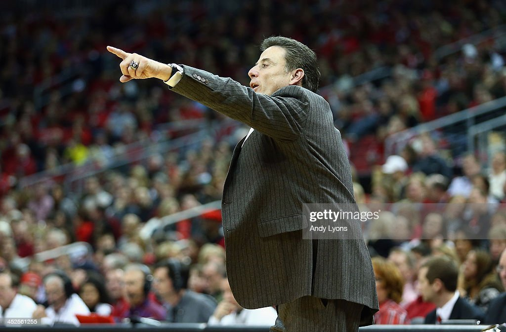 <a gi-track='captionPersonalityLinkClicked' href=/galleries/search?phrase=Rick+Pitino&family=editorial&specificpeople=210871 ng-click='$event.stopPropagation()'>Rick Pitino</a> the head coach of the Louisville Cardinals givees instructions to his team during the game against the Southern Mississippi Golden Eagles at KFC YUM! Center on November 29, 2013 in Louisville, Kentucky.