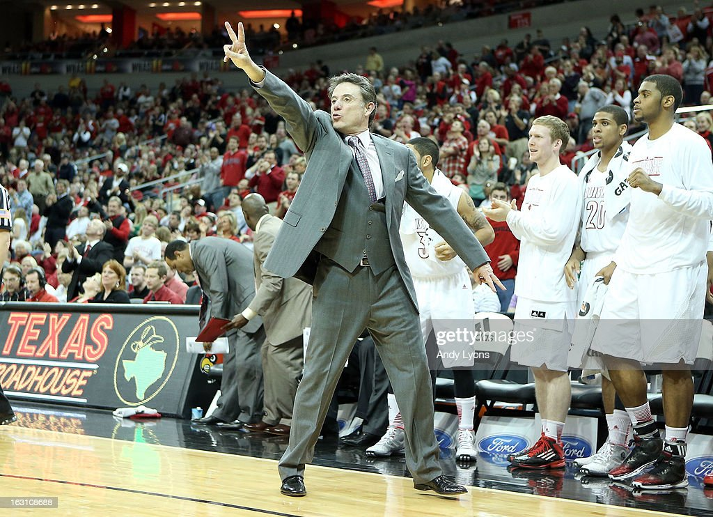 Rick Pitino the head coach of the Louisville Cardinals gives instructions to his team during the game against the Cincinnati Bearcats at KFC YUM! Center on March 4, 2013 in Louisville, Kentucky.