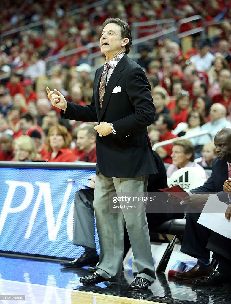 Rick Pitino the head coach of the Louisville Cardinals gives instructions to his team during the game against the Notre Dame Fighting Irish at KFC YUM! Center on March 9, 2013 in Louisville, Kentucky.