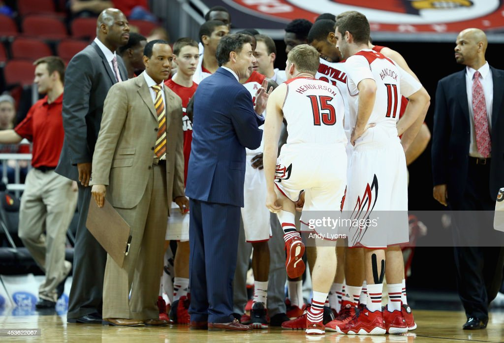 <a gi-track='captionPersonalityLinkClicked' href=/galleries/search?phrase=Rick+Pitino&family=editorial&specificpeople=210871 ng-click='$event.stopPropagation()'>Rick Pitino</a> the head coach of the Louisville Cardinals gives instructions to his team during the game against the Missouri-Kansas City Kangaroos at KFC YUM! Center on December 4, 2013 in Louisville, Kentucky.