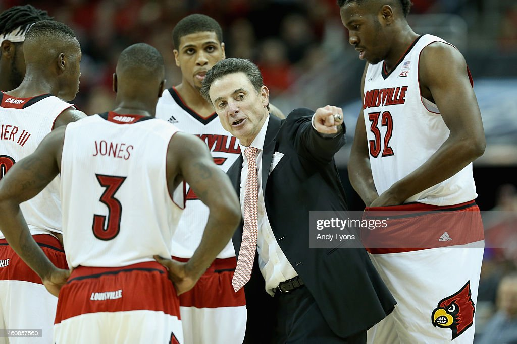 <a gi-track='captionPersonalityLinkClicked' href=/galleries/search?phrase=Rick+Pitino&family=editorial&specificpeople=210871 ng-click='$event.stopPropagation()'>Rick Pitino</a> the head coach of the Louisville Cardinals gives instructions to his team during the 58-50 loss to the Kentucky Wilcats at KFC YUM! Center on December 27, 2014 in Louisville, Kentucky.