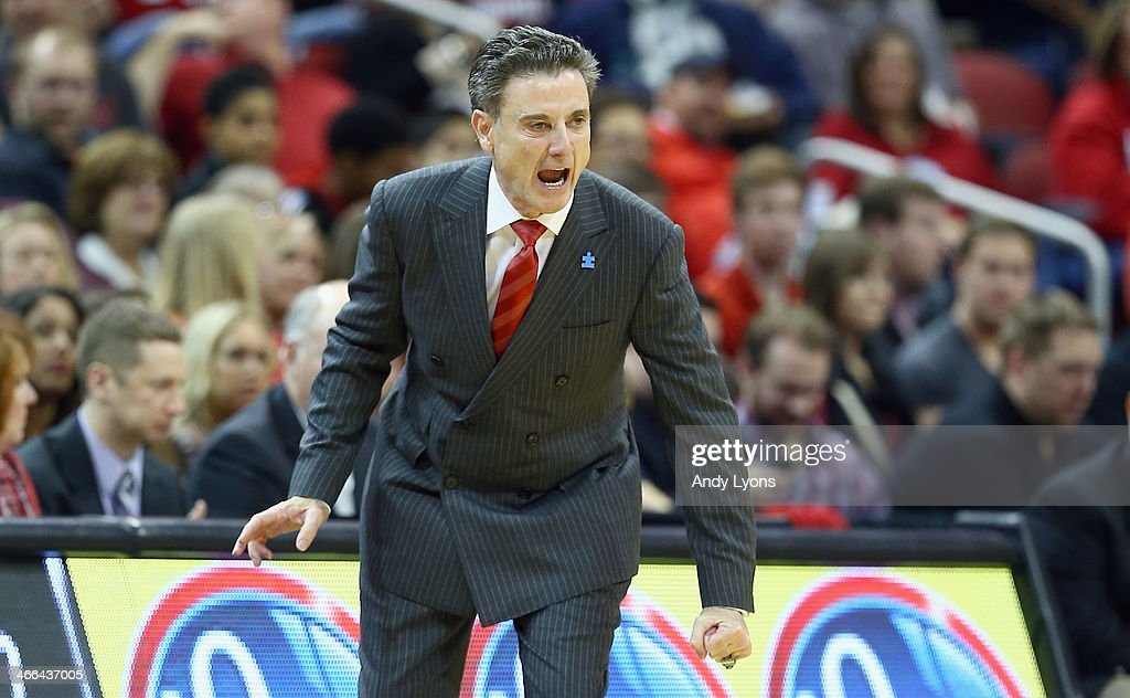 <a gi-track='captionPersonalityLinkClicked' href=/galleries/search?phrase=Rick+Pitino&family=editorial&specificpeople=210871 ng-click='$event.stopPropagation()'>Rick Pitino</a> the head coach of the Louisville Cardinals gives instructions to his team during the game against the Central Florida Knights at KFC YUM! Center on February 1, 2014 in Louisville, Kentucky.