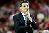 Rick Pitino the head coach of the Louisville Cardinals gives instructions to his team against the Florida State Seminoles at KFC YUM Center on...