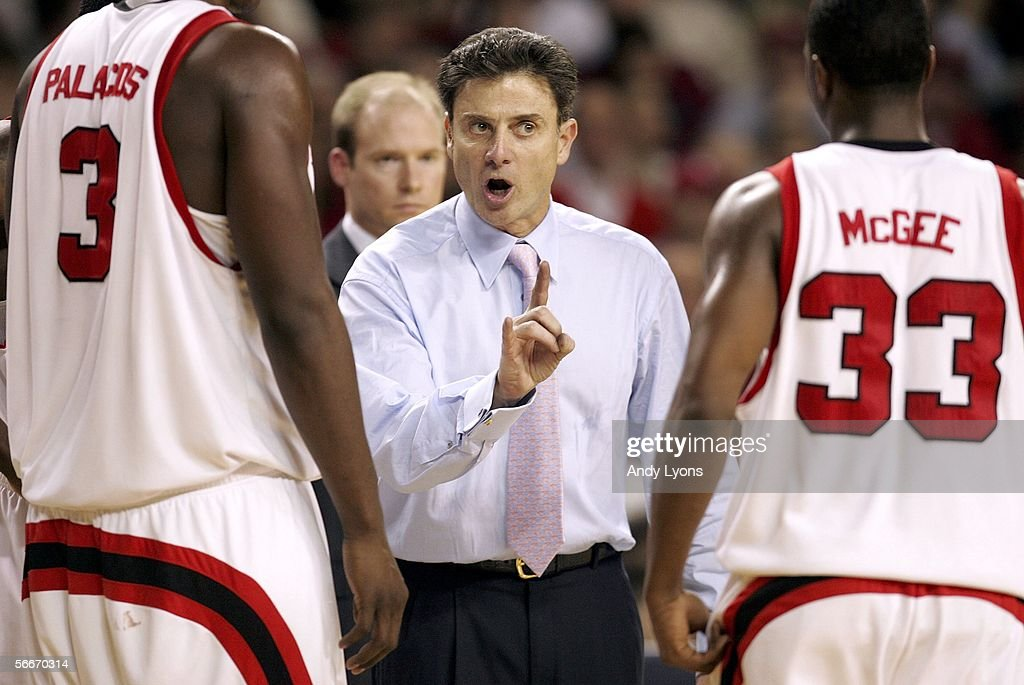 Rick Pitino the Head Coach of the Louisville Cardinals gives instructions to his team against the Cincinnati Bearcats at Freedom Hall on January 25, 2006 in Louisville, Kentucky. Louisville won 67-50.