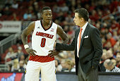 Rick Pitino the head coach of the Louisville Cardinals gives instructions to Terry Rozier during the game against the Bellarmine Kinghts at KFC YUM...