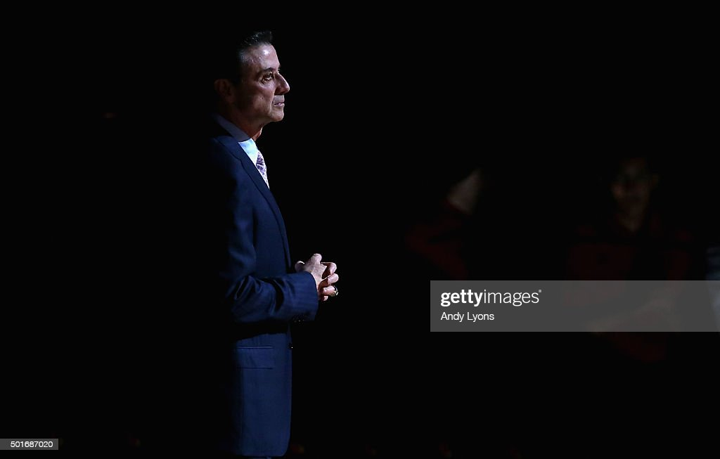 Rick Pitino the head coach of the Louisville Cardinals is introduced before the game against the Kennesaw State Owls at KFC YUM Center on December 16...