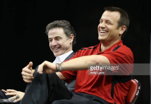 Rick Pitino the Mens head coach and Jeff Waltz the head coach of the Louisville Cardinals Womens team talks during the Louisville Cardinals NCAA...