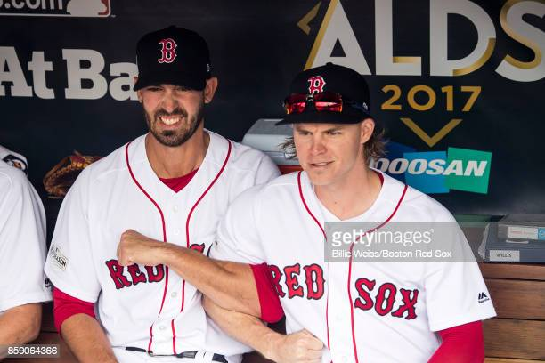 Rick Porcello and Brock Holt of the Boston Red Sox link arms before game three of the American League Division Series against the Houston Astros on...