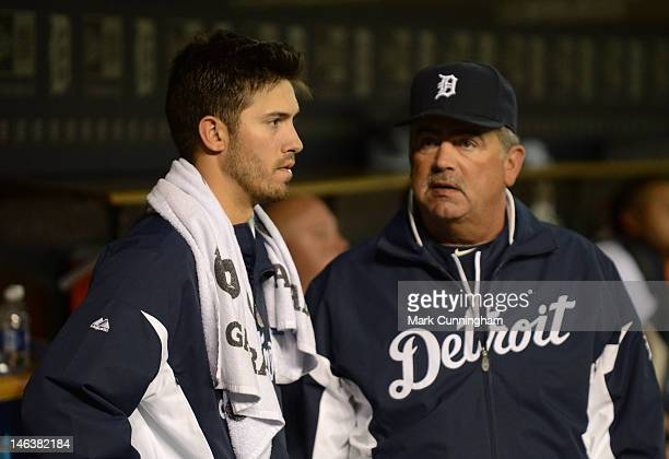 Rick Porcello and Jeff Jones of the Detroit Tigers talk in the dugout during the game against the New York Yankees at Comerica Park on June 2 2012 in...