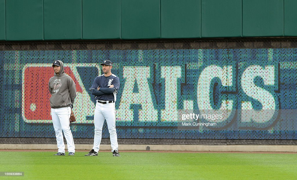 Rick Porcello #48 (L) and Justin Verlander #35 of the Detroit Tigers look on during warm ups prior to Game Four of the American League Championship Series against the New York Yankees at Comerica Park on October 18, 2012 in Detroit, Michigan. The Tigers defeated the Yankees 8-1 and now advance to the World Series.