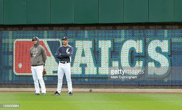 Rick Porcello and Justin Verlander of the Detroit Tigers look on during warm ups prior to Game Four of the American League Championship Series...