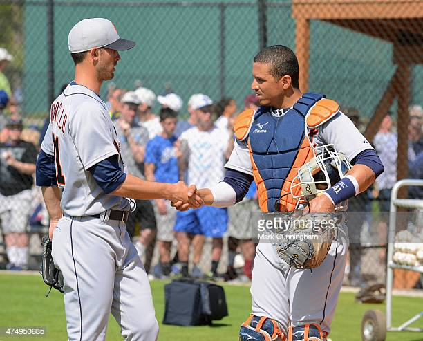 Rick Porcello and Victor Martinez of the Detroit Tigers shake hands during the spring training workout day at the TigerTown complex on February 19...