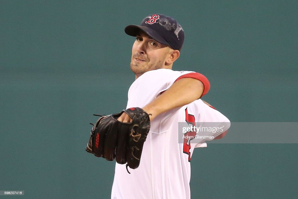 Rick Porcello of the Boston Red Sox delivers in the first inning during a game against the Tampa Bay Rays at Fenway Park on August 29 2016 in Boston...