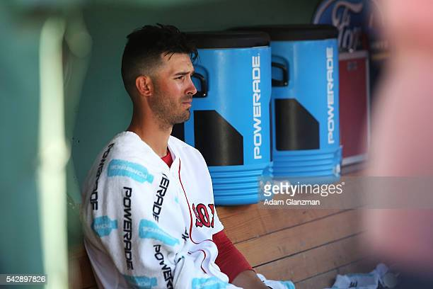 Rick Porcello of the Boston Red Sox looks on from the dugout in the third inning during the game against the Seattle Mariners at Fenway Park on June...