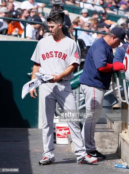 Rick Porcello of the Boston Red Sox stands in the dugout after being pulled from a game against the Detroit Tigers at Comerica Park on April 9 2017...