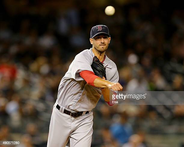 Rick Porcello of the Boston Red Sox tries to pick off Jacoby Ellsbury of the New York Yankees at first base in the second inning on September 29 2015...