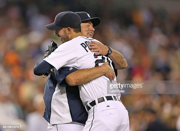 Rick Porcello of the Detroit Tigers celebrates with pitching coach Jeff Jones after pitching his second complete game shutout against the Oakland...