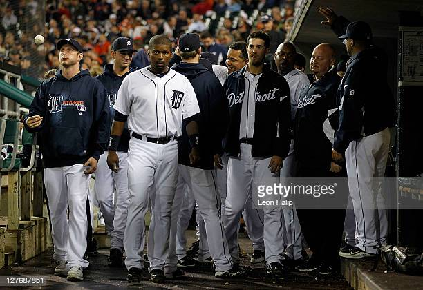 Rick Porcello of the Detroit Tigers is congratulted by his teammates during the game against the Cleveland Indians at Comerica Park on September 28...