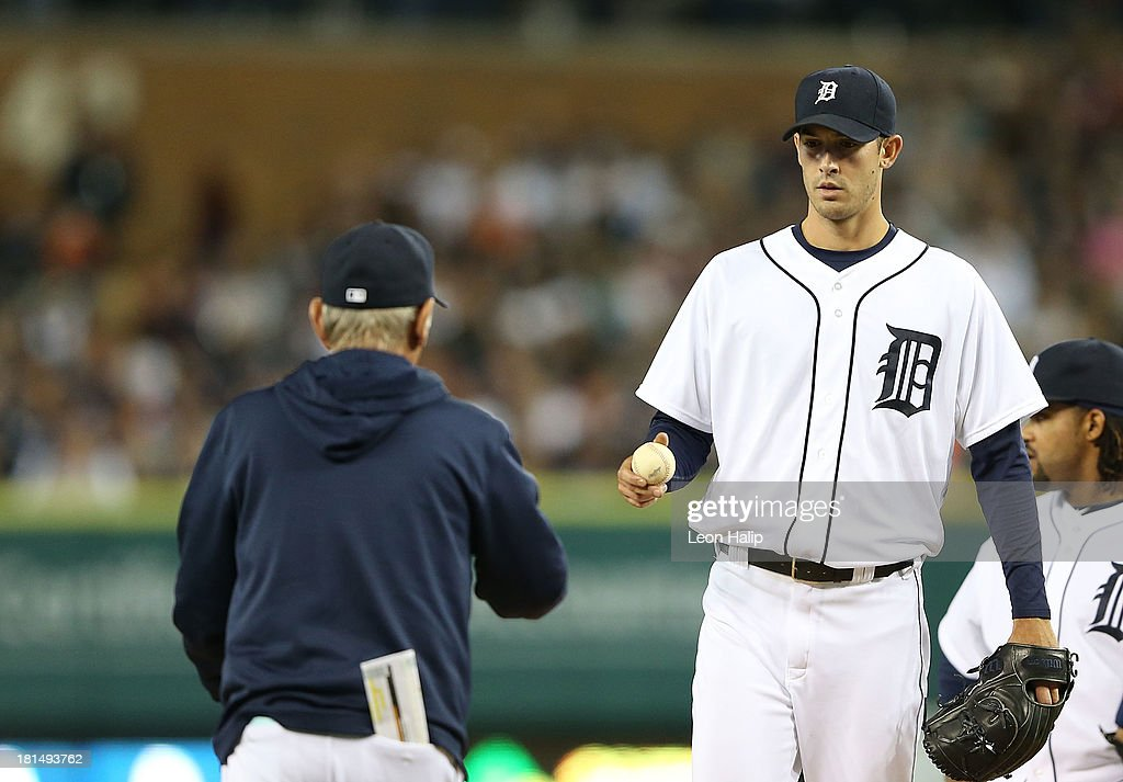 Rick Porcello #21 of the Detroit Tigers leaves the game and hands the ball to manager Jim Leyland #10 in the seventh inning of the game against the Chicago White Sox at Comerica Park on September 21, 2013 in Detroit, Michigan.