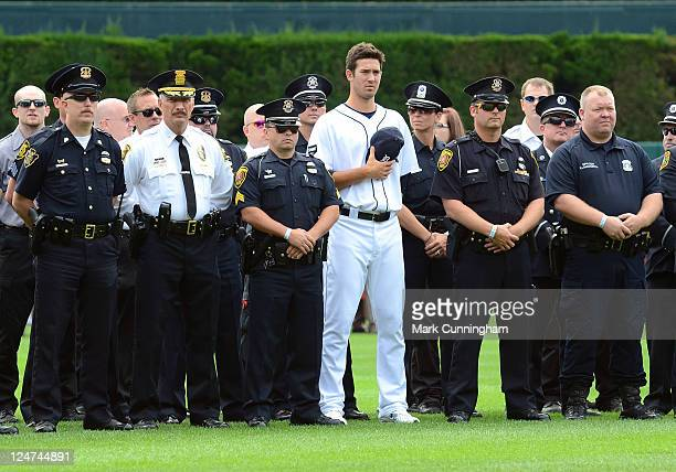 Rick Porcello of the Detroit Tigers stands along with members of local Police Departments during the Remembrance Day ceremonies to honor the 10th...