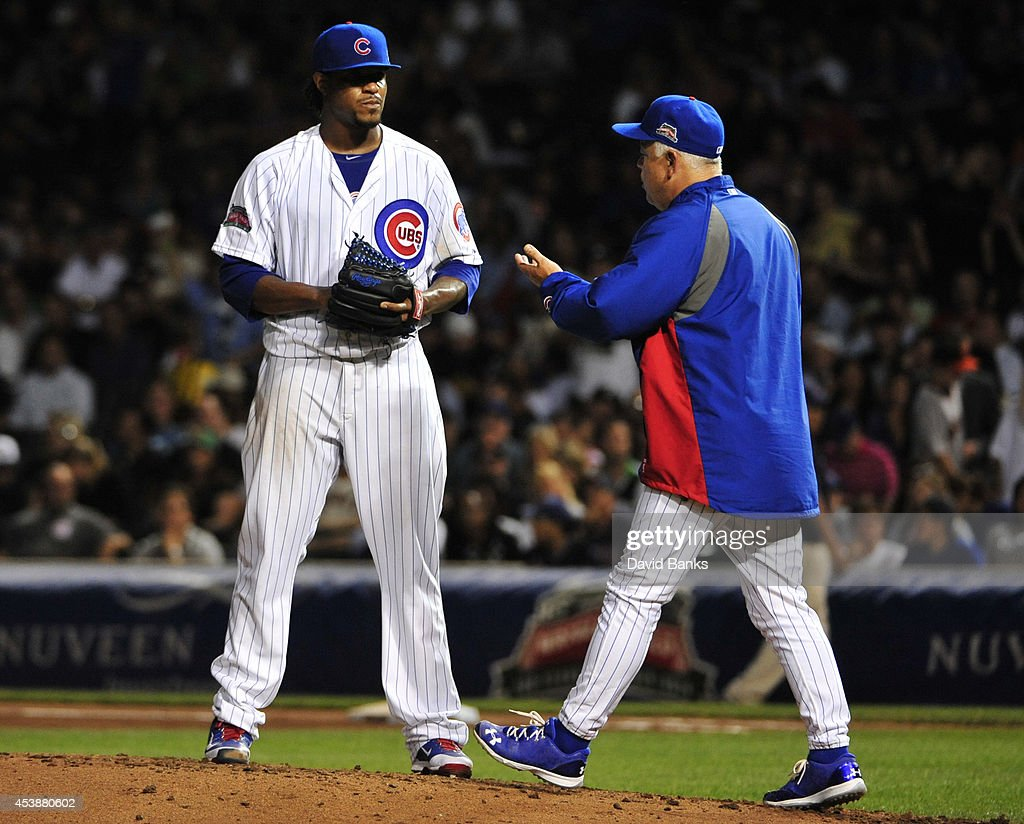 <a gi-track='captionPersonalityLinkClicked' href=/galleries/search?phrase=Rick+Renteria&family=editorial&specificpeople=5540001 ng-click='$event.stopPropagation()'>Rick Renteria</a> #16 manager of the Chicago Cubs takes <a gi-track='captionPersonalityLinkClicked' href=/galleries/search?phrase=Edwin+Jackson&family=editorial&specificpeople=220506 ng-click='$event.stopPropagation()'>Edwin Jackson</a> #36 out of the game against the San Francisco Giants during the third inning on August 20, 2014 at Wrigley Field in Chicago, Illinois.