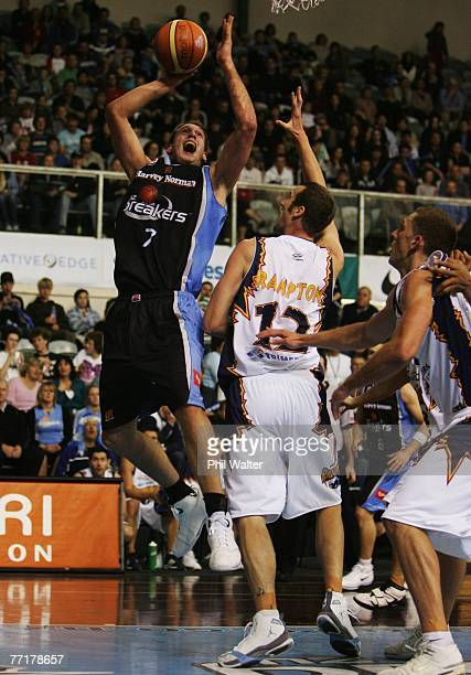 Rick Rickert of the New Zealand Breakers lays up the ball under pressure from Tony Rampton of the West Sydney Razorbacks during the round three NBL...