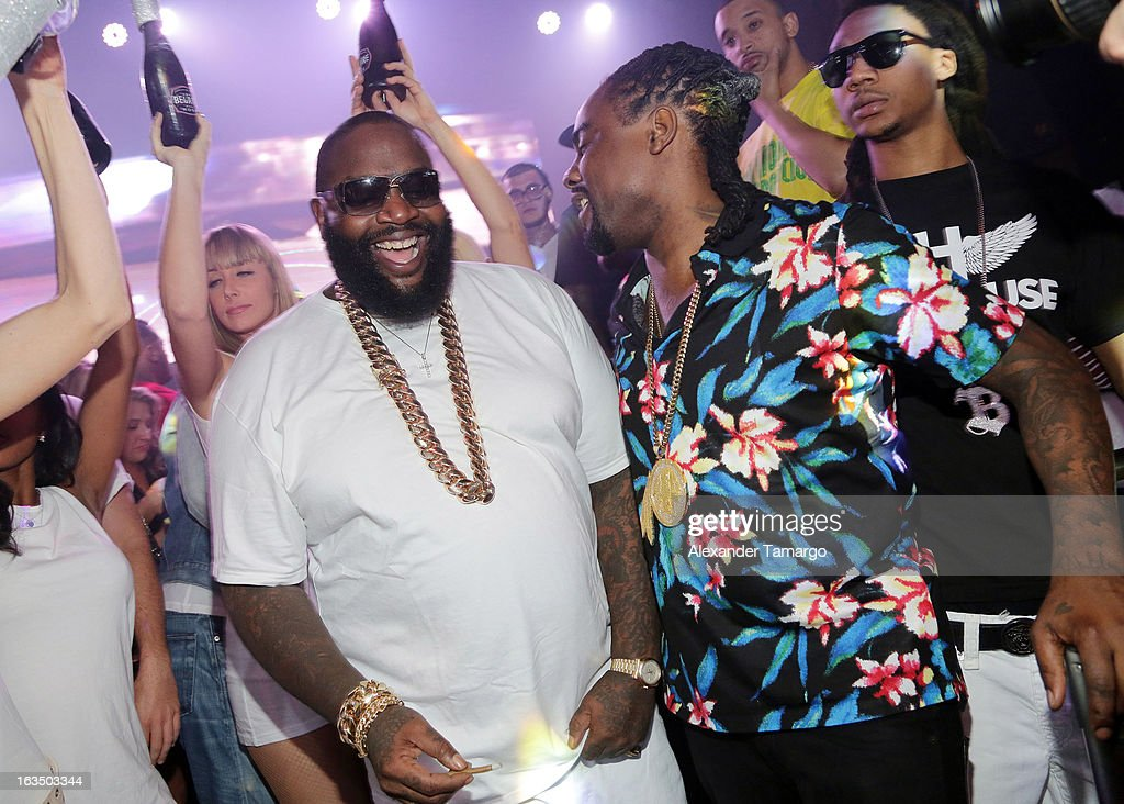 Rick Ross (C) nd Wale are seen at the Reebok Classic white party hosted by Rick Ross at LIV nightclub at Fontainebleau Miami on March 10, 2013 in Miami Beach, Florida.