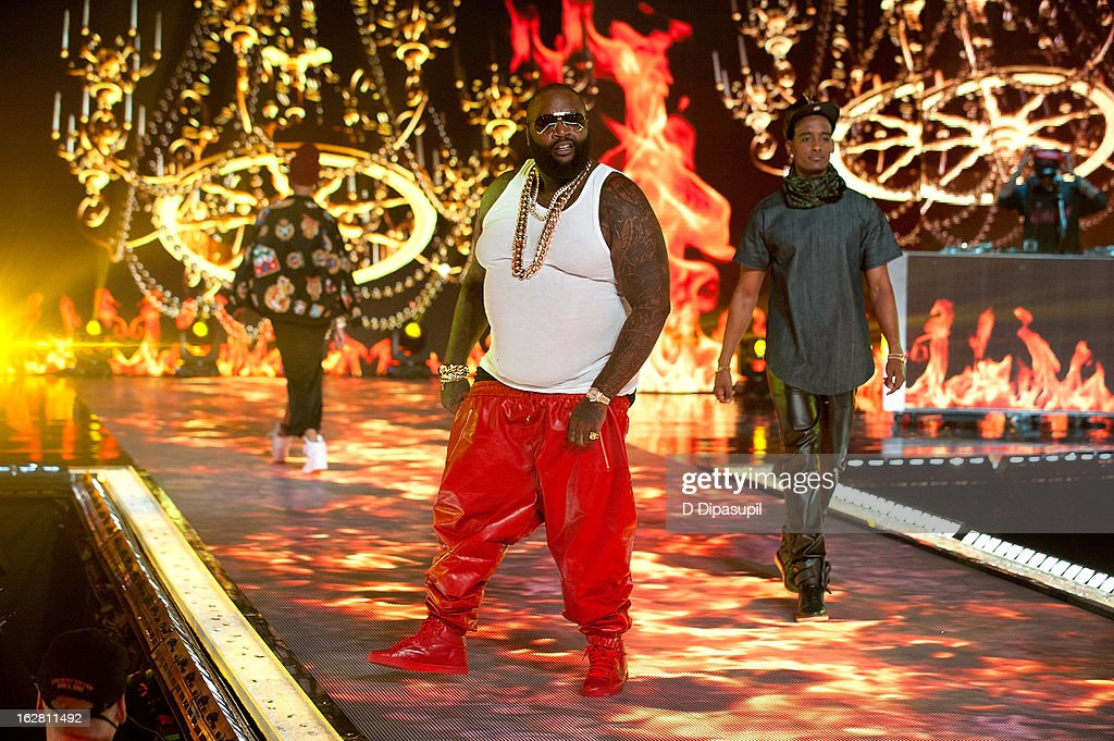 Rick Ross (C) performs during BET's Rip The Runway 2013 at Hammerstein Ballroom on February 27, 2013 in New York City.