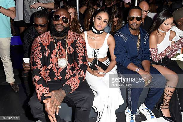 Rick Ross Regina Perera and Juicy J attends the Hood By Air fashion show during New York Fashion Week The Shows at The Arc Skylight at Moynihan...