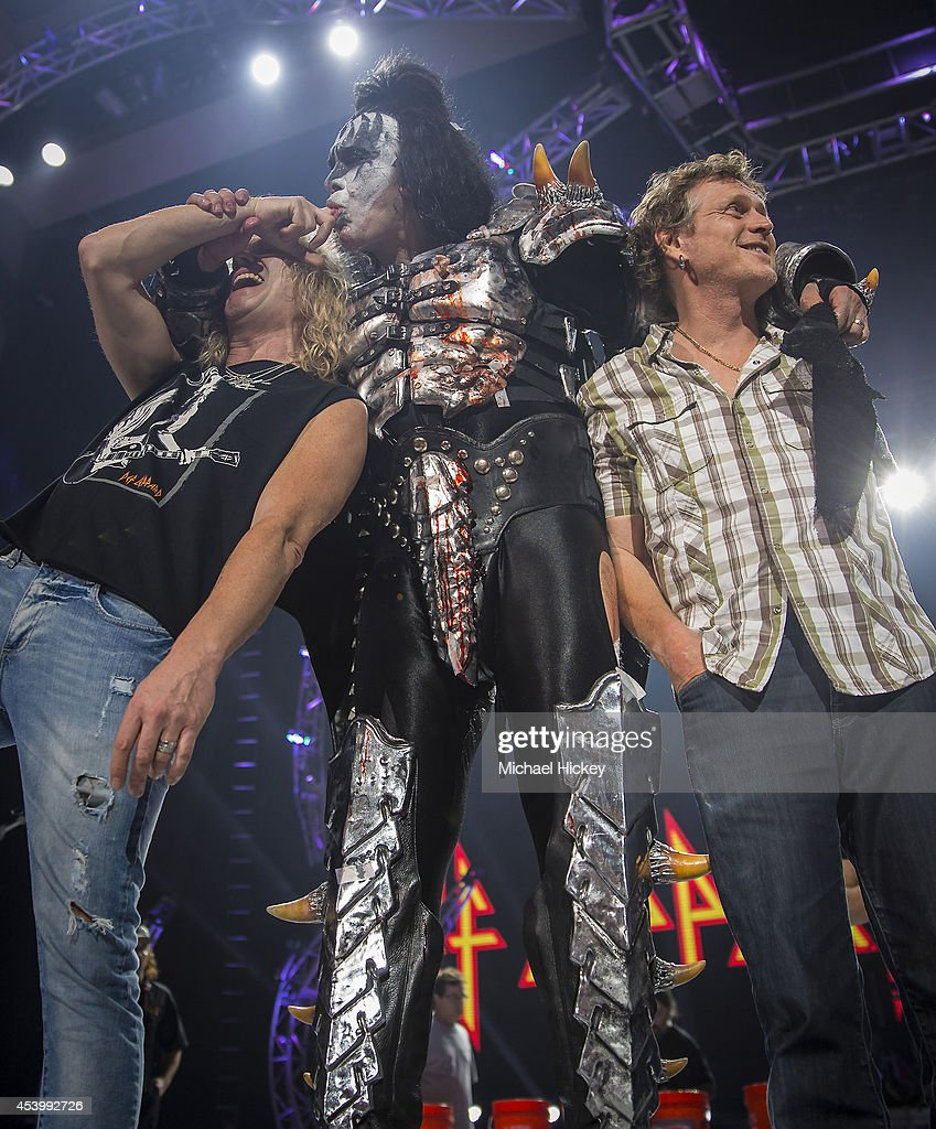 Rick Savage of Def Leppard Gene Simmons of KISS and Rick Allen of Def Leppard are seen on stage before participating in the ALS Ice Bucket Challenge...