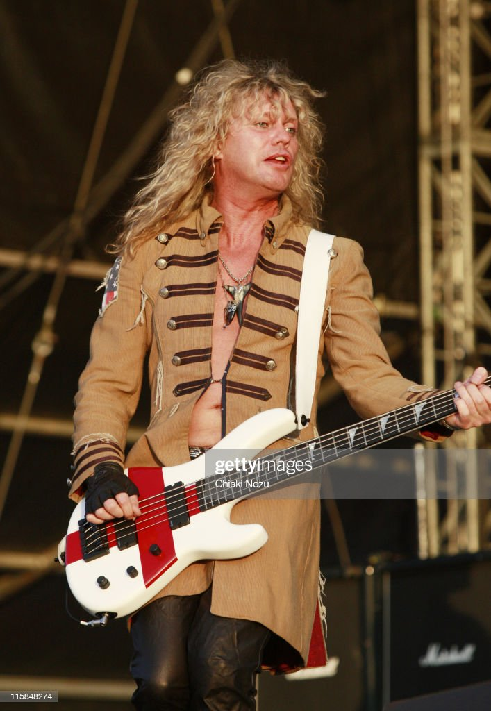 Rick Savage of Def Leppard performs at day three of the Download Festival at Donington Park on June 14, 2009 in Castle Donington, England.