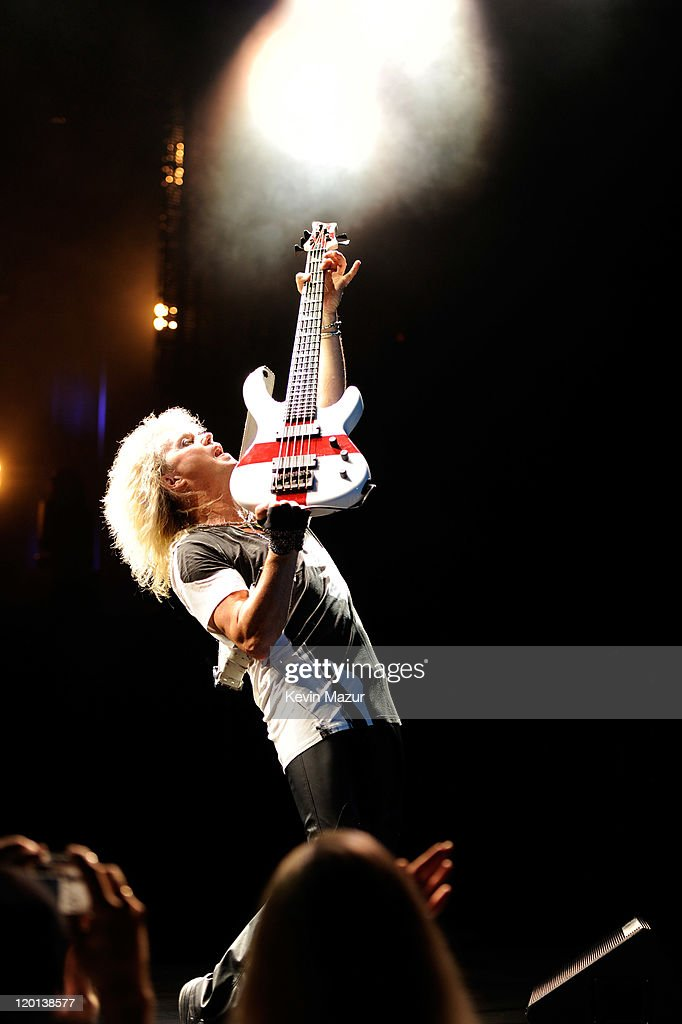 Rick Savage of Def Leppard performs at Nikon at Jones Beach Theater on July 30, 2011 in Wantagh, New York.