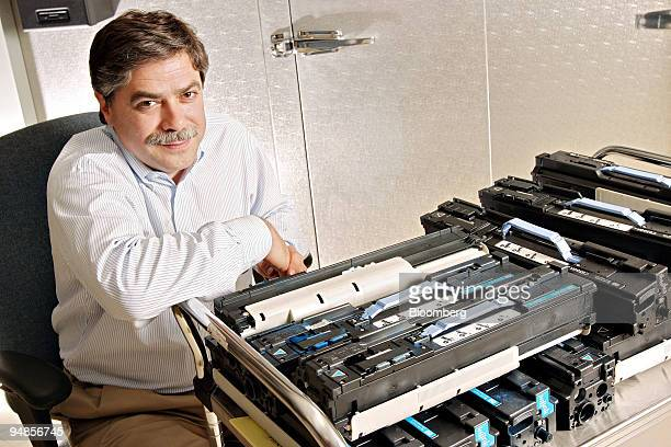 Rick Seymour vice president of LaserJet Supplies for HewlettPackard poses with a cart of HP toner cartridges in a company toner lab in Boise Idaho...