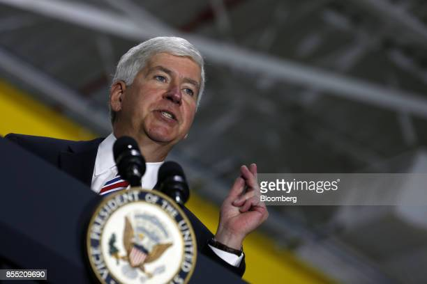 Rick Snyder governor of Michigan speaks during an event with US Vice President Mike Pence not pictured at the American Axle Manufacturing Inc...