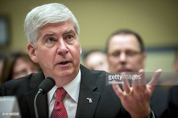 Rick Snyder governor of Michigan testifies during a House Oversight and Government Reform Committee hearing in Washington DC US on Thursday March 17...