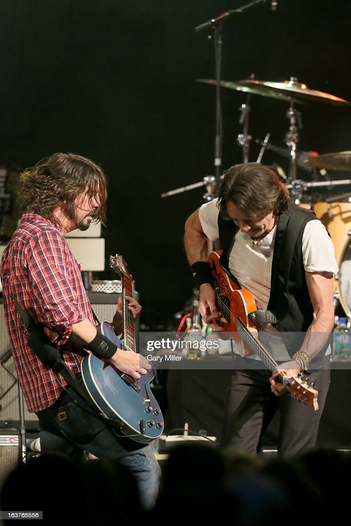 Rick Springfield (R) and Dave Grohl perform in concert at the Sound City showcase at Stubbs BBQ during the South By Southwest Music Festival on March 14, 2013 in Austin, Texas.